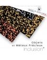 Inclusioni di oggetti e metalli preziosi